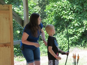Lily teaching Archery